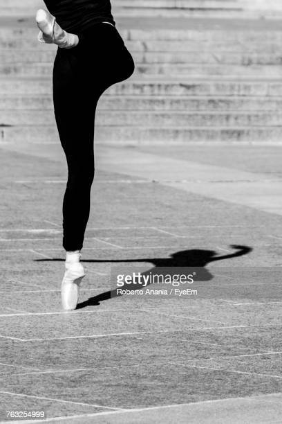 Low Section Of Woman Ballet Dancer On Footpath
