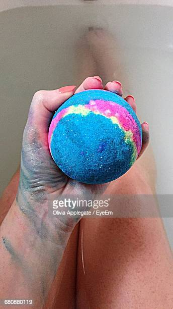Low Section Of Woman Holding Bath Bomb