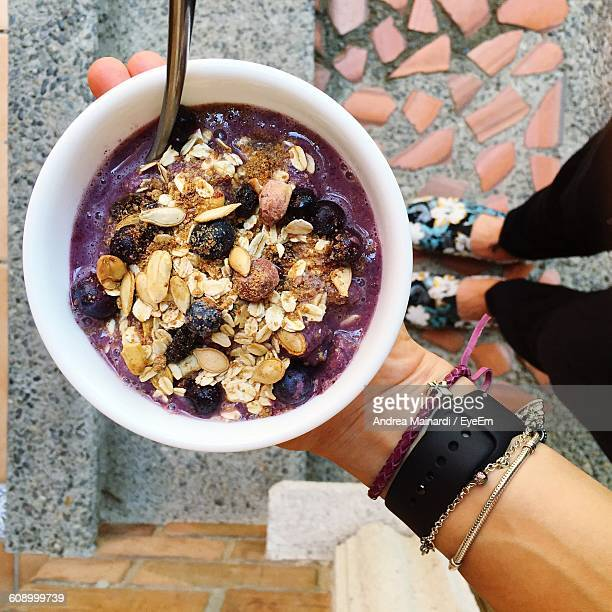 Low Section Of Woman Holding Smoothie Bowl