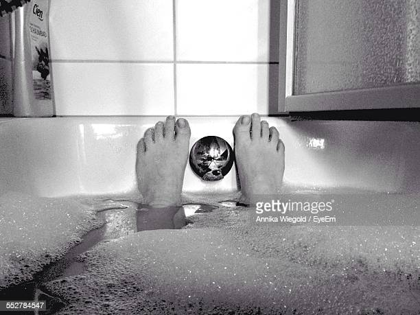 Low Section Of Woman In Bathtub