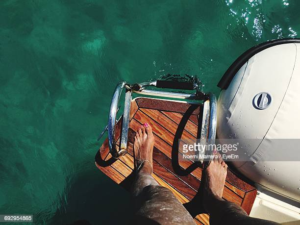 Low Section Of Woman Standing On Boat In Sea
