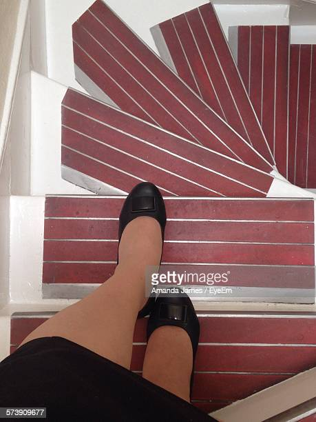 Low Section Of Woman Walking Down Stairs