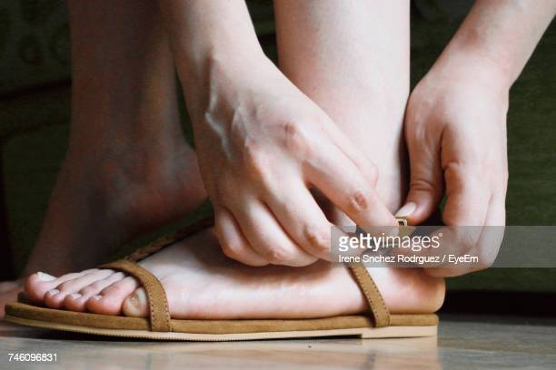 Low Section Of Woman Wearing Sandals