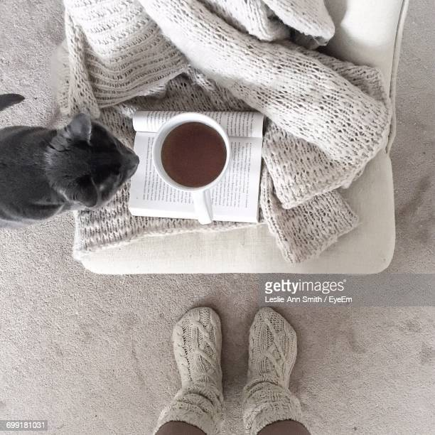 Low Section Of Woman With Coffee Cup On Table
