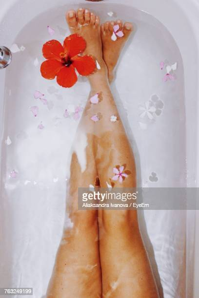 Low Section Of Woman With Legs In Bathtub