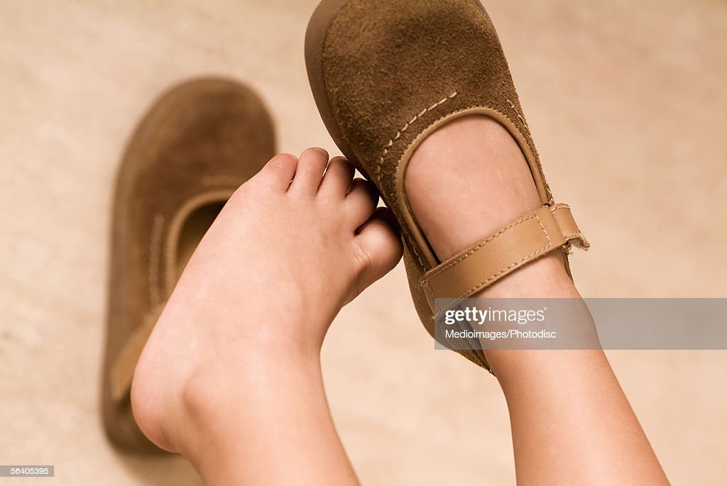 Low section view of a child's feet