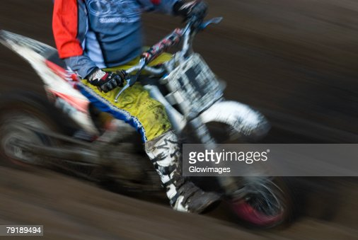 Low section view of a man on a racing bike : Foto de stock