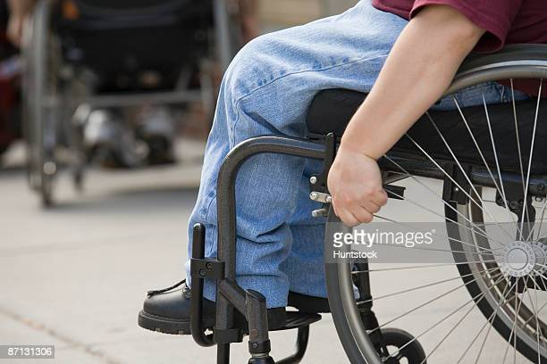 Low section view of a person sitting in a wheelchair