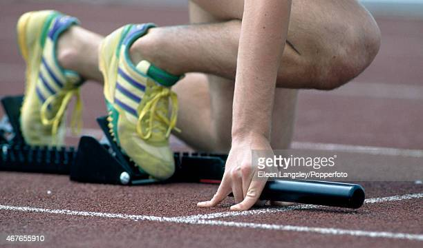 Low section view of an athlete in the starting blocks prior to a relay race circa 1994