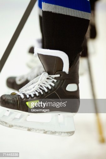 Low section view of an ice hockey player with an ice hockey stick