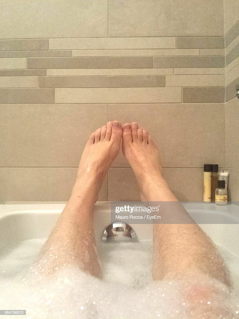 Low Section View Of Man In Bathtub : Photo