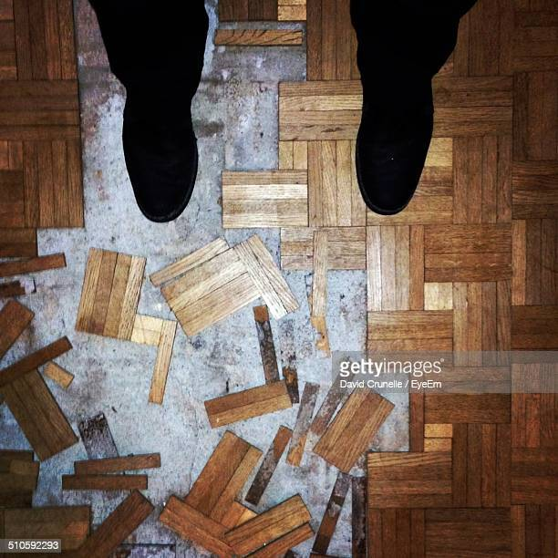 Low section view of man standing on under renovating flooring