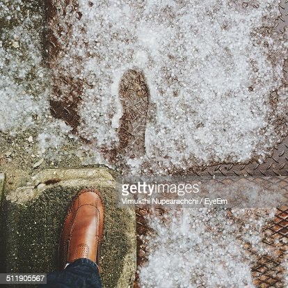 Low section view of person foot on rock