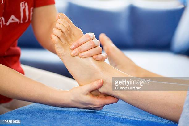 Low section view of person receiving foot massage
