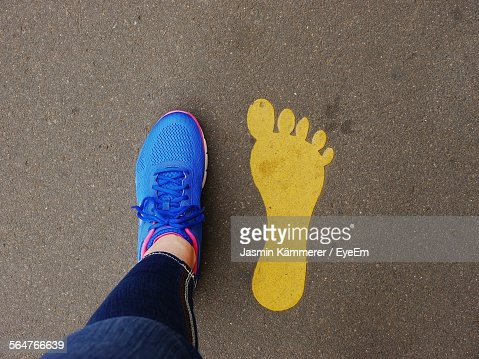 Low Section View Of Person Standing On Footprint
