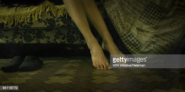 Low section view of woman's feet on the floor, Lugansk, Ukraine