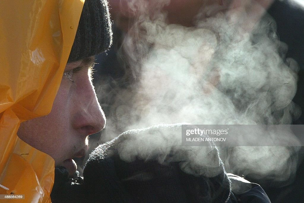 Low temperatures cause steam to come out from the breath of a supporters of proWestern opposition leader Viktor Yushchenko during a rally in central...