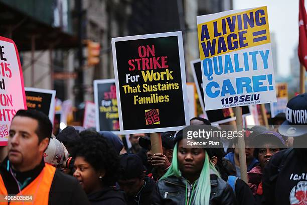 Low wage workers and supporters protest for a $15 an hour minimum wage on November 10 2015 in New York United States In what organizers are calling a...