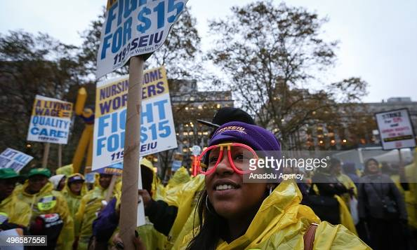 Low wage workers and supporters protest for a $15 an hour minimum wage on November 10 2015 at Foley Square in New York United States The protesters...