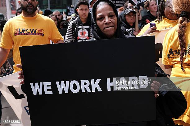 Low wage workers many in the fastfood industry join with supporters to demand a minimum wage of $15 an hour on April 15 2015 in New York City In what...