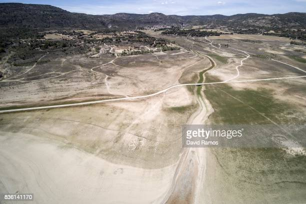 Low water levels are seen visible on the banks of Entrepenas reservoir second largest water reservoir feeding the Segura River and Spain's...