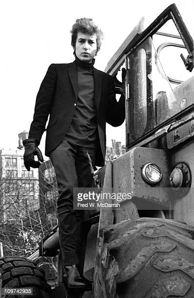 Lowangle portrait of American musician Bob Dylan as he stands on a bulldozer in Sheridan Square Park New York New York January 22 1965