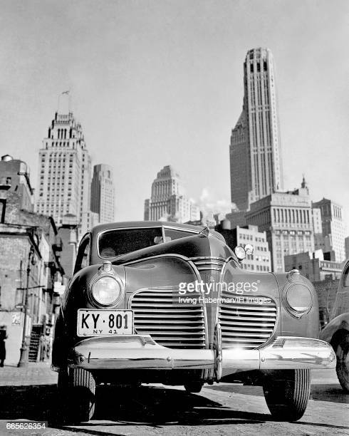 Lowangle view of a Plymouth car with the Manhattan skyline in the background New York New York 1941