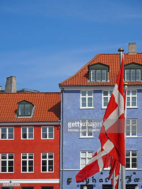 Low-Angle View Of Danish Flag In Old Town