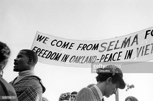 Protesters from Selma carry a banner that reads 'We Come From Selma For Freedom In Oakland Peace In Vietnam' as they participate in the Vietnam Day...