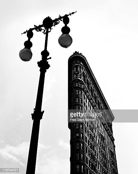 Lowangle view of the Flatiron Building framed by a street lamp New York New York 1947