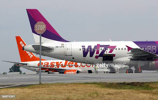 Lowcost carriers Wizz Air and Easyjet airplanes prepare for takeoff in front of a stop sign at Ferihegy International Airport in Budapest Hungary...
