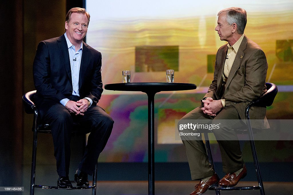 Lowell C. McAdam, chairman and chief executive officer of Verizon Communications Inc., right, and Roger S. Goodell, commissioner of the National Football League, converse during a keynote address at the 2013 Consumer Electronics Show in Las Vegas, Nevada, U.S., on Tuesday, Jan. 8, 2013. The 2013 CES trade show, which runs until Jan. 11, is the world's largest annual innovation event that offers an array of entrepreneur focused exhibits, events and conference sessions for technology entrepreneurs. Photographer: David Paul Morris/Bloomberg via Getty Images