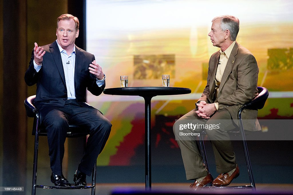 Lowell C. McAdam, chairman and chief executive officer of Verizon Communications Inc., right, listens while Roger S. Goodell, commissioner of the National Football League, speaks during a keynote address at the 2013 Consumer Electronics Show in Las Vegas, Nevada, U.S., on Tuesday, Jan. 8, 2013. The 2013 CES trade show, which runs until Jan. 11, is the world's largest annual innovation event that offers an array of entrepreneur focused exhibits, events and conference sessions for technology entrepreneurs. Photographer: David Paul Morris/Bloomberg via Getty Images