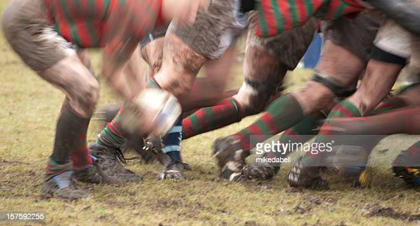 Lower body view of rugby scrum in action