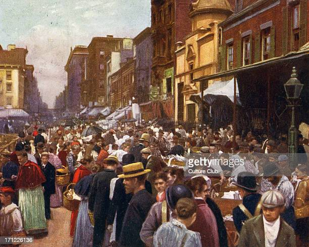 Lower East Side New York 1890s with passersby strolling down the streets next to the market stalls Caption reads 'Cosmopolitan New York The ghetto...