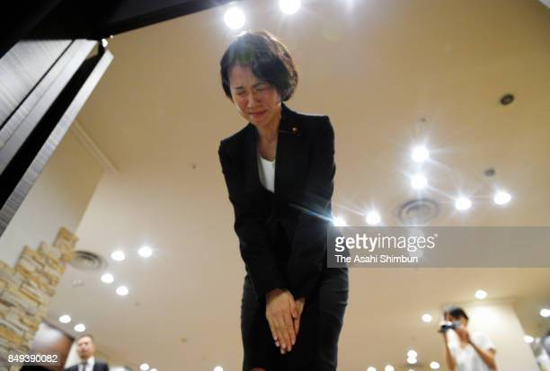 Lower house lawmaker Mayuko Toyota bows for apology at the end of a press conference after the meeting with her supporters t her constituency on...