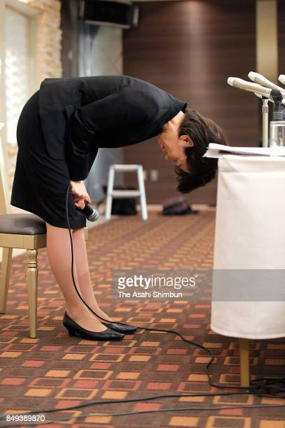 Lower house lawmaker Mayuko Toyota bows for apology during a press conference after the meeting with her supporters t her constituency on September...