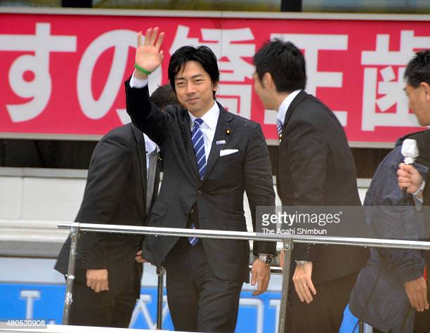 Lower house lawmaker Shinjiro Koizumi waves to supporters after a street speech on December 3 2011 in Morioka Iwate Japan