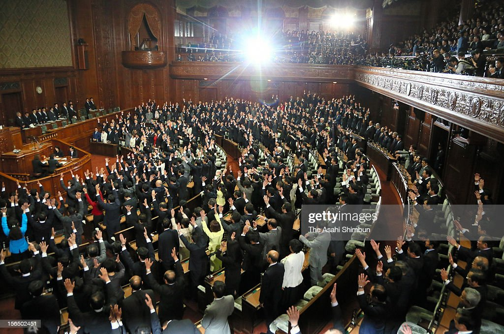 Lower house lawmakers make banzai cheers at the Diet building on November 16, 2012 in Tokyo, Japan. Prime Minister Yoshihiko Noda dissolved the lower house, call a snap election, which voting day is December 16.
