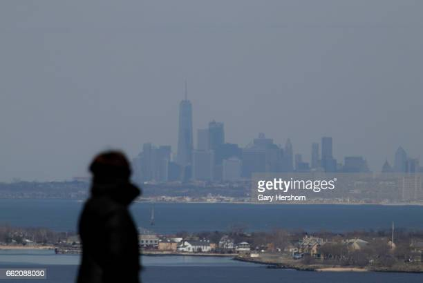 Lower Manhattan and One World Trade Center in New York City looms behind Sandy Hook NJ on March 30 as seen from Mt Mitchill in Atlantic Highlands NJ
