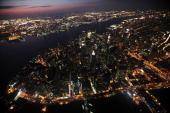 Lower Manhattan is lit up as night falls September 13 2009 in New York City
