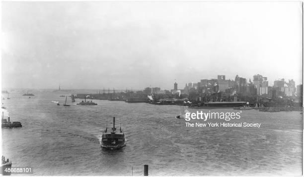 Lower Manhattan skyline and New York Harbor viewed from Brooklyn Bridge New York New York mid 1900s