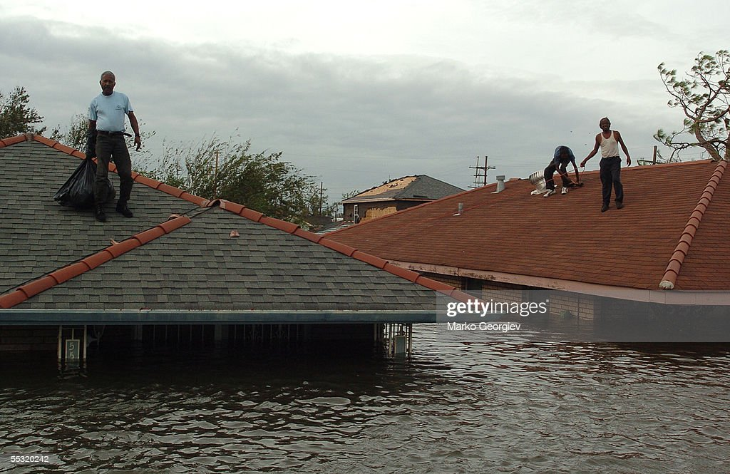 Lower Ninth Ward residents stranded on the roofs wait for a rescue boats in New Orleans & Hurricane Katrina Pictures | Getty Images memphite.com