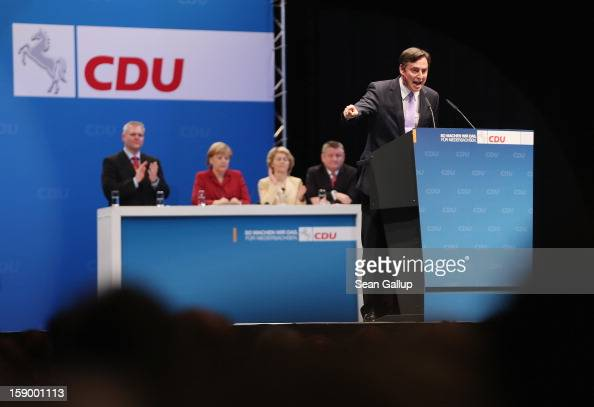 Lower Saxony Governor and German Christian Democrats incumbent candidate David McAllister speaks to supporters as German Chancellor and CDU...