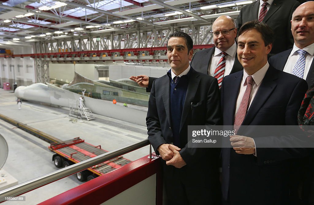 Lower Saxony Governor and incumbant candidate of the German Christian Democrats (CDU) David McAllister (R) and German Environment Minister Peter Altmaier (2nd from L) pause while touring the Enercon wind turbine factory with Enercon head Hans-Dieter Kettwig (L) on January 4, 2013 in Aurich, Germany. Lower Saxony is holding state elections on January 20 and many analysts see the election as a bellwether for national elections scheduled to take place later this year.