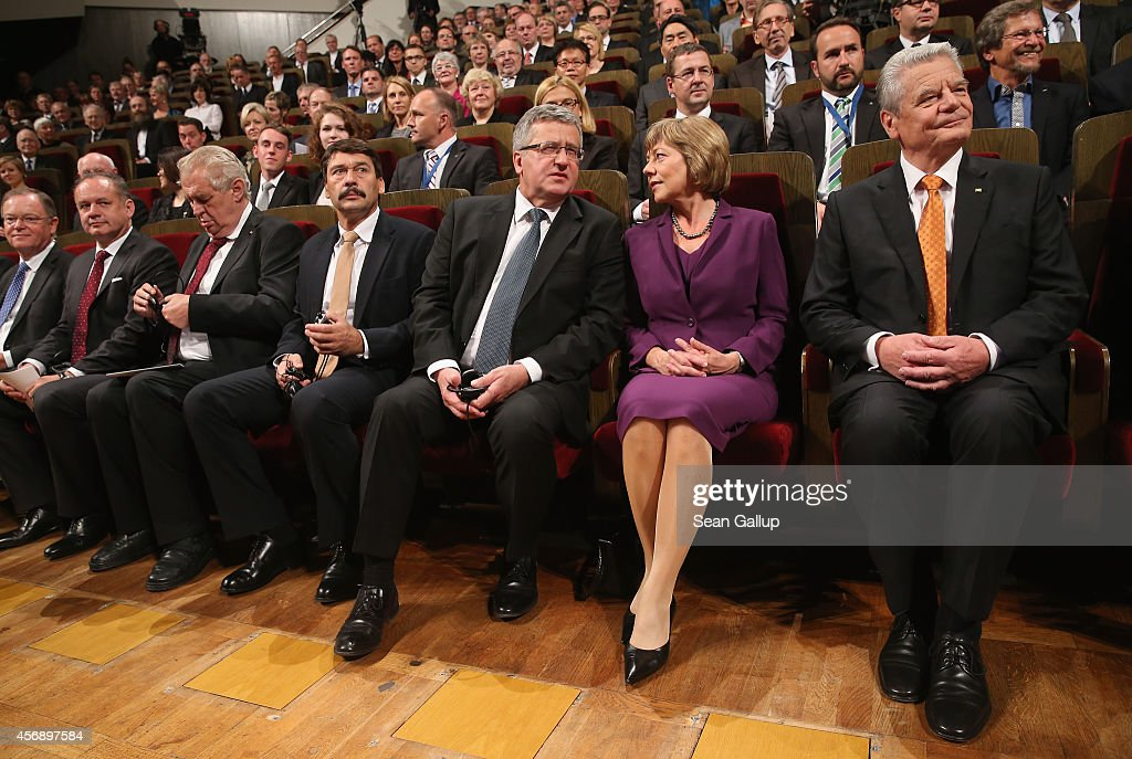Lower Saxony Governor Stefan Weil, Slovak President Andrej Kiska, Czech President Milos Zeman, Hungarian President Janos Ader, Polish President Bronislaw Komorowski, German First Lady Daniela Schadt and German President Joachim Gauck take their seats in the Gewandhaus concert hall for commemorations marking the 25th anniversary of the mass protests in Leipzig that preceded the fall of the communist government of East Germany on October 9, 2014 in Leipzig, Germany. On October 9, 1989, following weeks of protests that had resulted in beatings and arrests by police, 70,000 protesters demanding greater freedom marched unopposed through the city in a historic event that signaled the beginning of the end of the communist government's authority. Only a month later the infamous Berlin Wall fell, breaking the near isolation of East Germans under communist dictatorship. Revolutions continued to sweep across Eastern Europe and within months all of the communist governments collapsed.