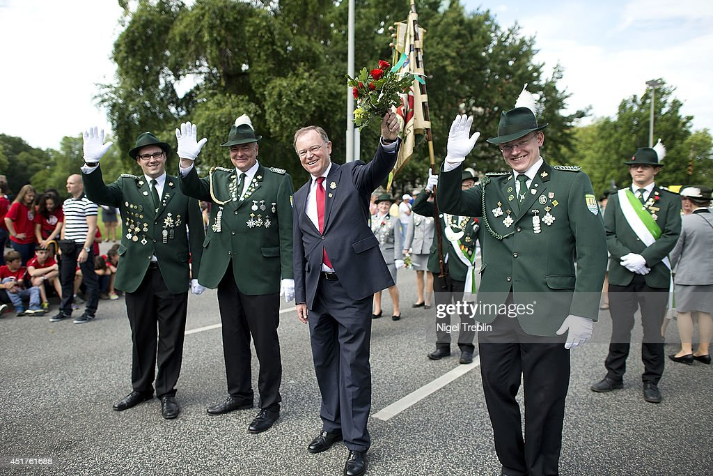 Lower Saxony Governor <a gi-track='captionPersonalityLinkClicked' href=/galleries/search?phrase=Stephan+Weil&family=editorial&specificpeople=4683319 ng-click='$event.stopPropagation()'>Stephan Weil</a> waves to the crowd during a parade at the world's largest shooting fair, known as Schutzenfest, on July 6, 2014 in Hanover, Germany. A Schutzenfest, or German 'Marksmen's Festival' is a traditional festival featuring a target shooting competition in the cultures of both Germany and Switzerland. Reports indicate that more than a million visitors are expected to attend the 2014 Marksmen's Festival.