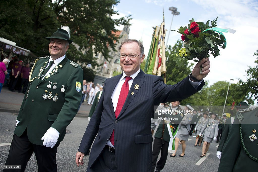 Lower Saxony Governor Stephan Weil waves to the crowd during a parade at the world's largest shooting fair, known as Schutzenfest, on July 6, 2014 in Hanover, Germany. A Schutzenfest, or German 'Marksmen's Festival' is a traditional festival featuring a target shooting competition in the cultures of both Germany and Switzerland. Reports indicate that more than a million visitors are expected to attend the 2014 Marksmen's Festival.