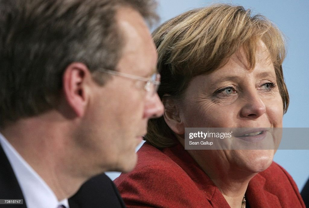 Lower Saxony State Governor Christian Wulff and German Chancellor <a gi-track='captionPersonalityLinkClicked' href=/galleries/search?phrase=Angela+Merkel&family=editorial&specificpeople=202161 ng-click='$event.stopPropagation()'>Angela Merkel</a> speak at a press conference after a meeting of German state governors at the Chancellery December 13, 2006 in Berlin, Germany. State governors from across Germany met in Berlin to discuss, among other issues, reforms to the German federal system as well as a national ban on smoking in restaurants, bars, hospitals and schools. Recent legislation failed after lawmakers could not decide whether the ban is a federal or state-level issue.