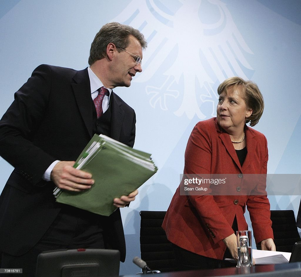 Lower Saxony State Governor Christian Wulff and German Chancellor <a gi-track='captionPersonalityLinkClicked' href=/galleries/search?phrase=Angela+Merkel&family=editorial&specificpeople=202161 ng-click='$event.stopPropagation()'>Angela Merkel</a> conclude a press conference after a meeting of German state governors at the Chancellery December 13, 2006 in Berlin, Germany. State governors from across Germany met in Berlin to discuss, among other issues, reforms to the German federal system as well as a national ban on smoking in restaurants, bars, hospitals and schools. Recent legislation failed after lawmakers could not decide whether the ban is a federal or state-level issue.